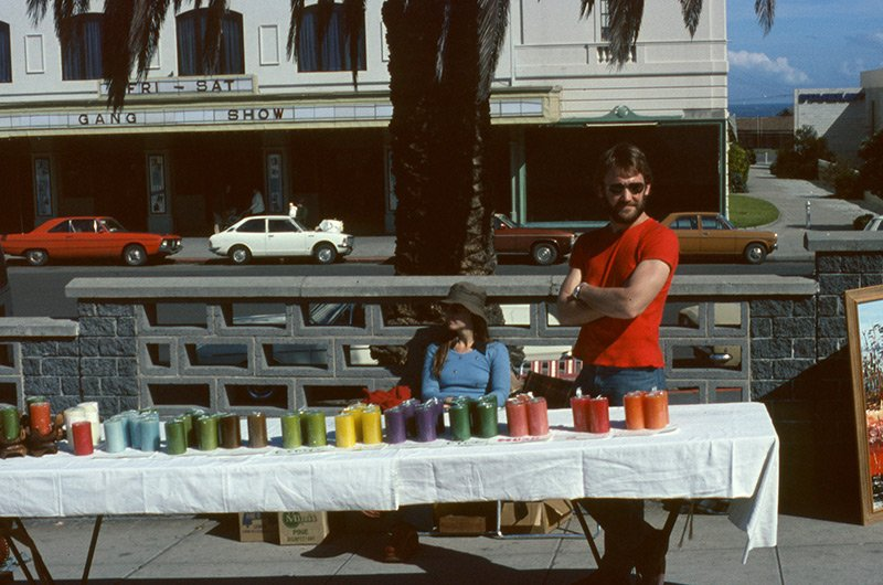 Maureen Buckley & Chris Phillips selling candles at St Kilda Esplanade Market